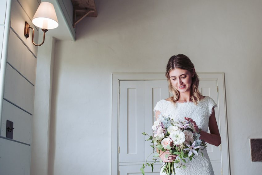 Bride admires her bouquet.
