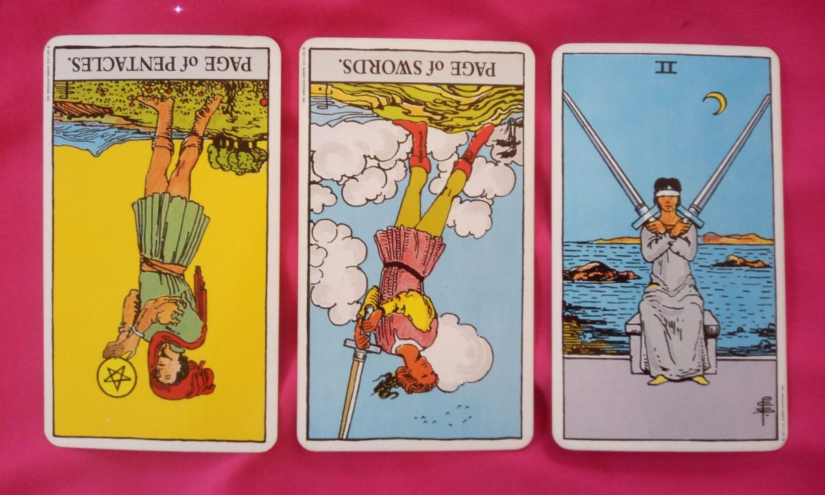 daily online soul purpose tarot reading cards: Page of Pentacles reversed, Page of Swords reversed, 2 of Swords reversed