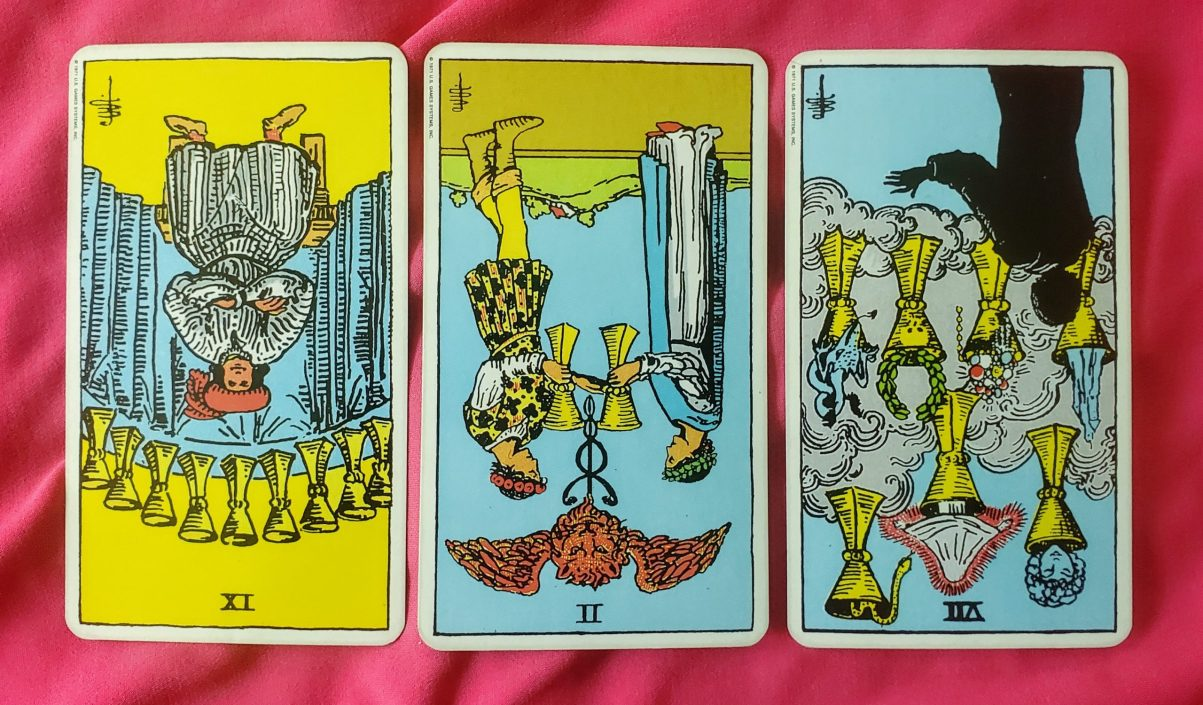 Weekly online soul purpose tarot reading cards: 9 of Cups reversed, 2 of Cups reversed, 7 of Cups reversed