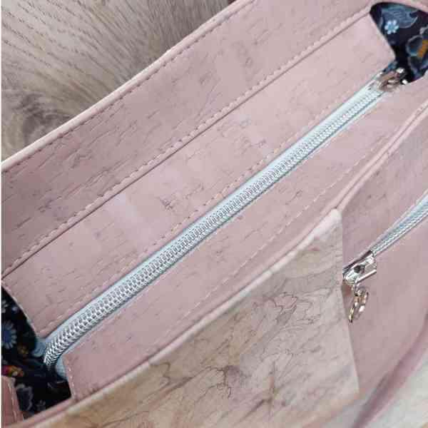 kurk tas-schoudertas roze met witte details bovenkant
