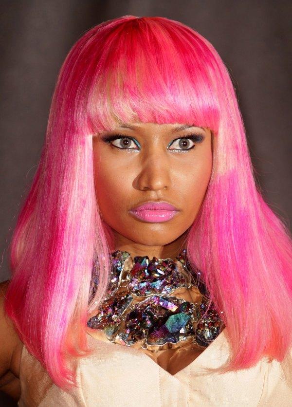 Nicki Minaj Shows Of 12 Colourful Wigs