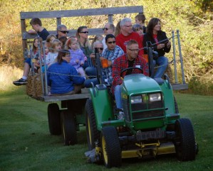 members on tractor and hay ride