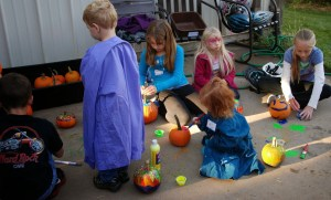 children painting pumpkins at the fall festival