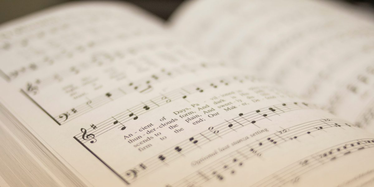 shallow focus photography of musical note book