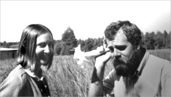 """Fred with Sue Endeman. """"I remember Fred as having a great and quirky sense of humor. He could be serious one moment in a conversation and then the next be sarcastic or cynical and expressing that tone with a funny accent, as evident in the picture where he is putting a flower in his ear asking Sue to repeat what she just said or say it louder"""""""