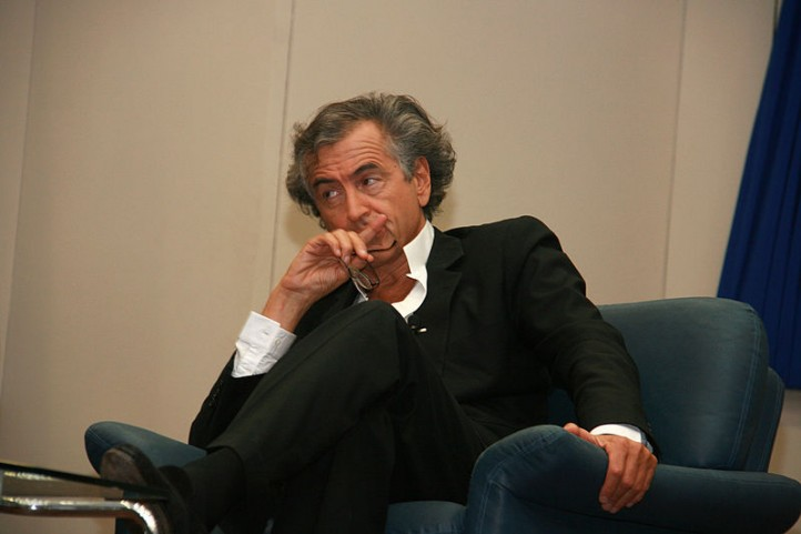 """Philosopher"" Bernard Henri-Levy (aka, BHL) worked undercover as a journalist to engineer the deal with Libya, thus paving the way for yet more journalists to be accused of being spies. (Photo: Itzik Edri / Wikimedia Commons)"