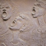 Musical group singing carved on clay, art deco