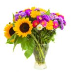 bouquet of mixed autumn flowers in vase isolated on white background