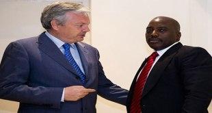 Photo d'un ministre belge et le president congolais, en train de parler.