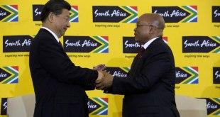 Xi and Zuma hand shake