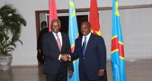 "Hand shake between presidents Dos SANTOS and ""Joseph KABILA""."