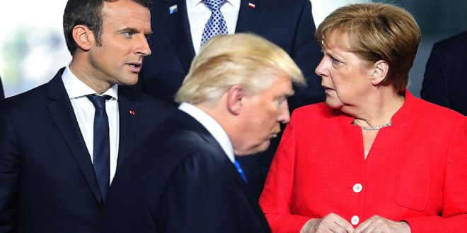 Emmanuel MACRON and Angela MERKEL [at the back], and Donald TRUMP passing in front of them