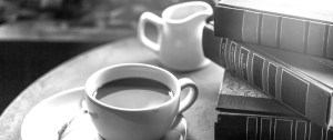 Coffee cup and books