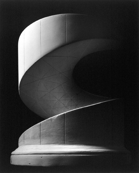Black-and-white photograph of a cylinder with an inset spiralling ramp