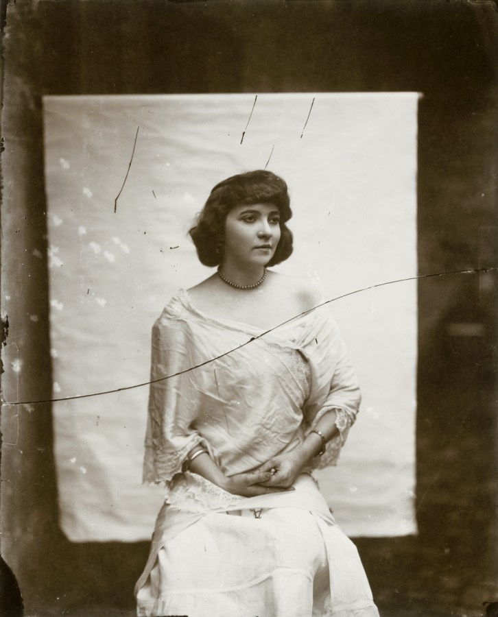 Black-and-white photograph of a woman in front of a white backdrop