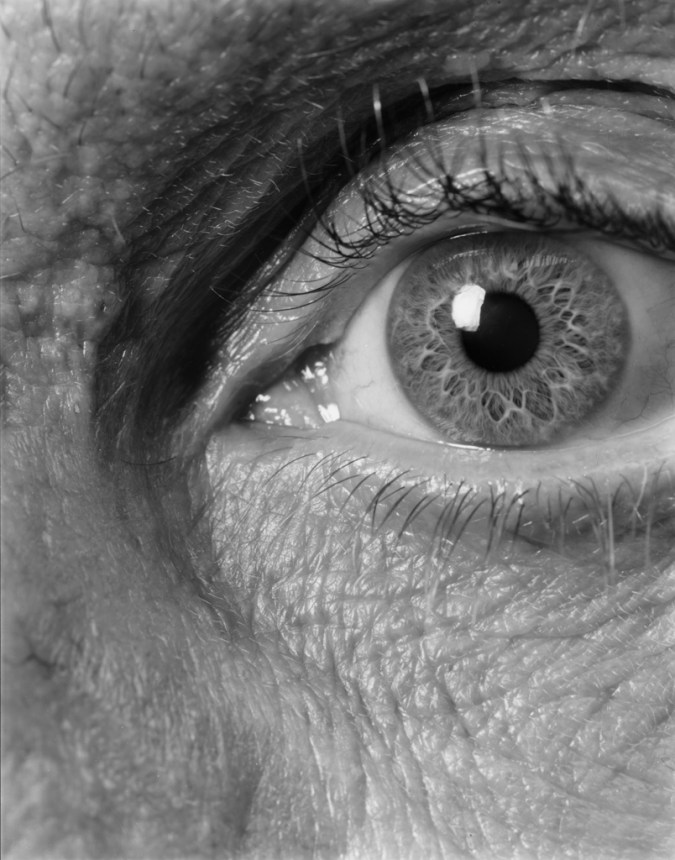 Black-and-white close-up photograph of an open eye