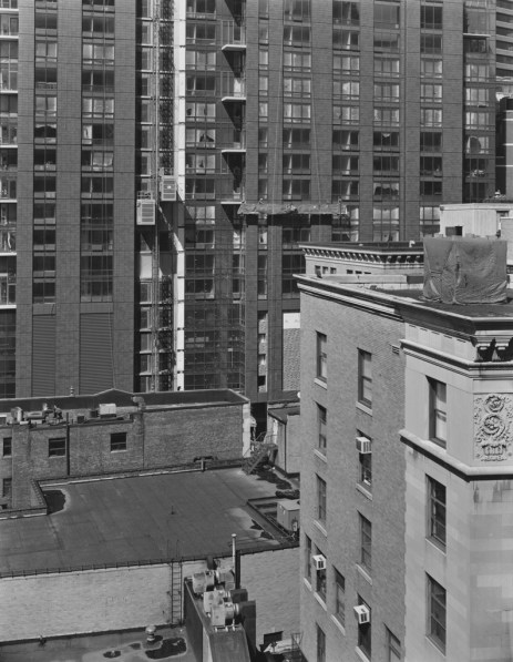 Black-and-white photograph of city buildings from various eras
