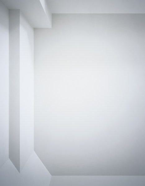 Photograph of a white ceiling with simple linear architectural details in varying shades of light gray