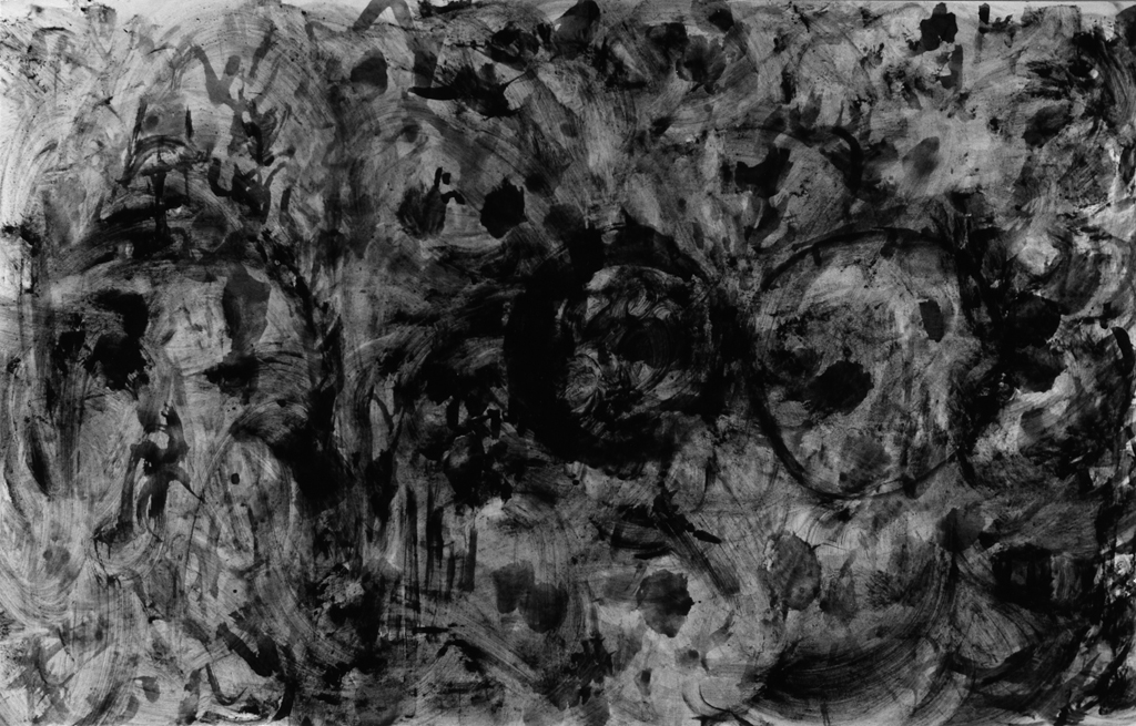 Black-and-white photograph of an abstract pattern of black blobs and swirls on a dark gray background