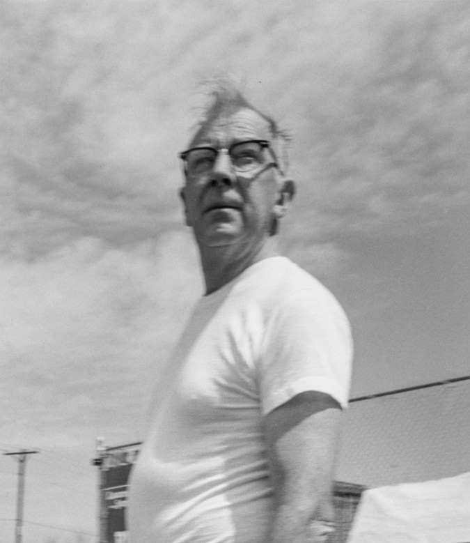 Black-and-white photograph of a man wearing glasses