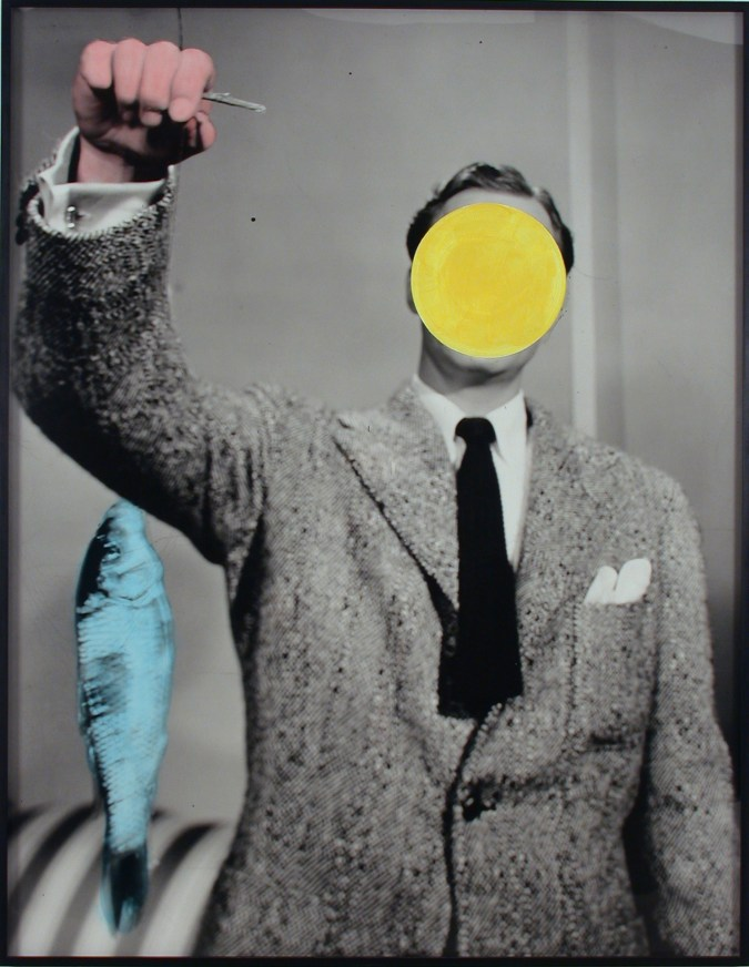 Black and white photograph of a man holding up a blue fish with a yellow circle superimposed on his face