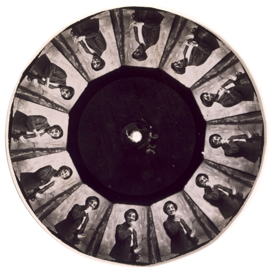 Circular photograph of repeating images of person in a suit jacket arranged around the center