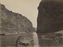 Black and white photograph of a river winding through a rocky canyon