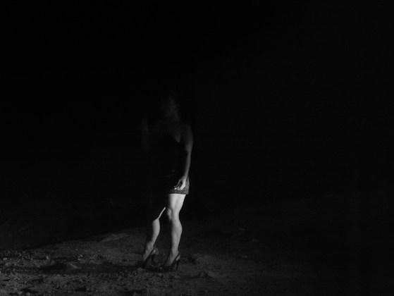 Wanda Stands Alone Under 9th Street Bridge, Modesto, CA, 2013, pigment print