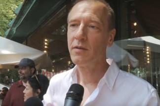 Video still of a man being interviewed