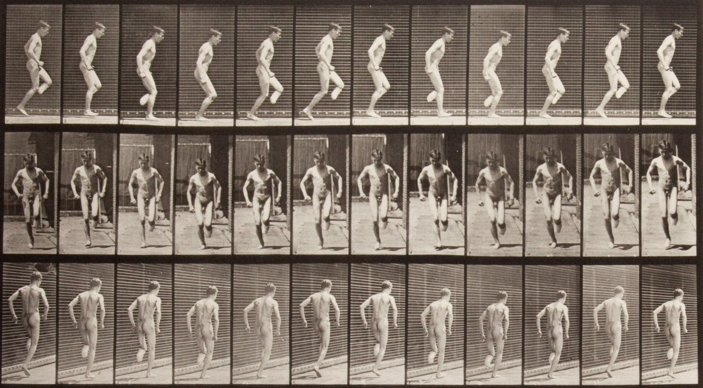 Three rows of small black and white photographs of a nude man hopping on his foot.