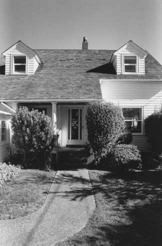 Black-and-white vertical photograph of a house.