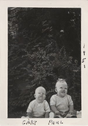 "Painting of two babies with ""Gary"" ""Paul"" and ""1951"" written at the edges"