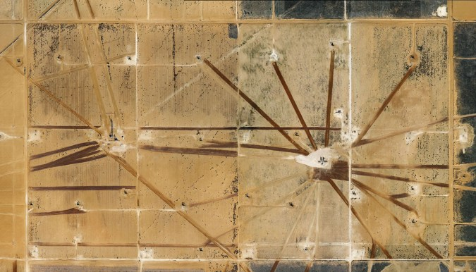 Color photograph of an oil field photographed from above.