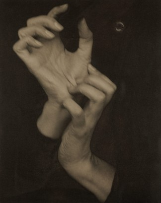 Toned black and white photograph of a woman's hands.