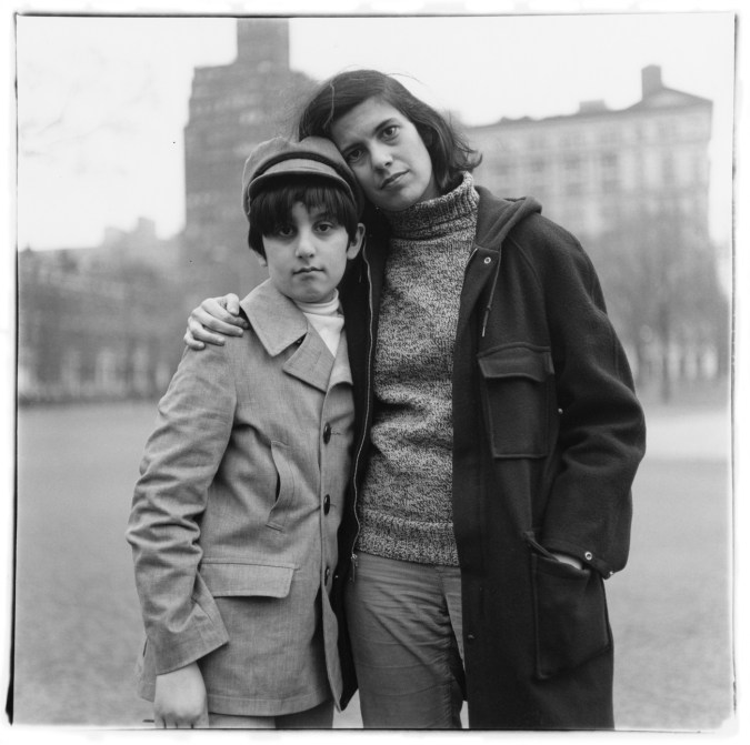 Black-and-white photograph of a woman with her arm around a boy