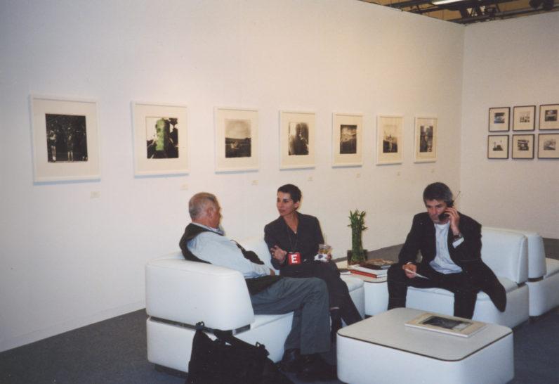 Lee Friedlander, Frish Brandt and Jeffrey Fraenkel at an art fair, New York, 2002