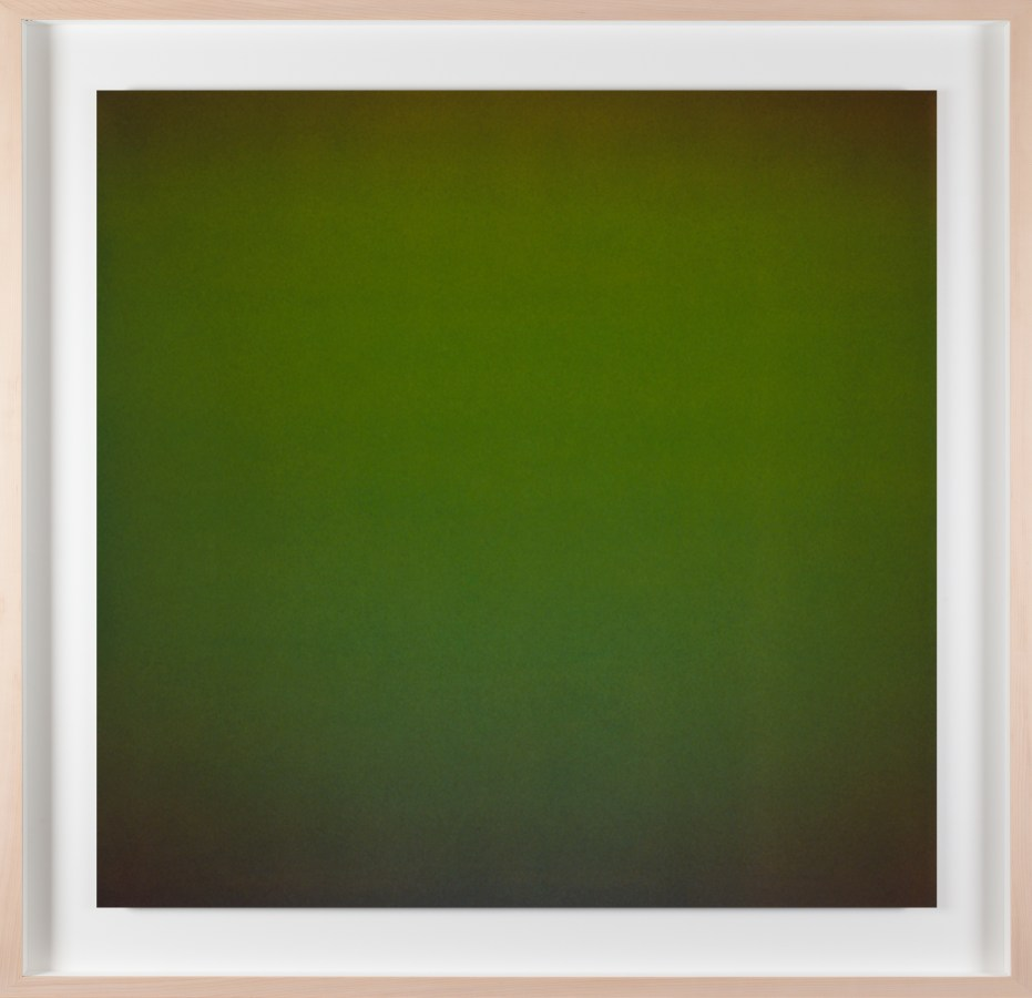 A framed photograph of a color field that is forrest green in the center and dark green at each corner