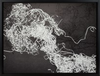 A framed abstract monoprint, of a pile of tape pulled from a casette