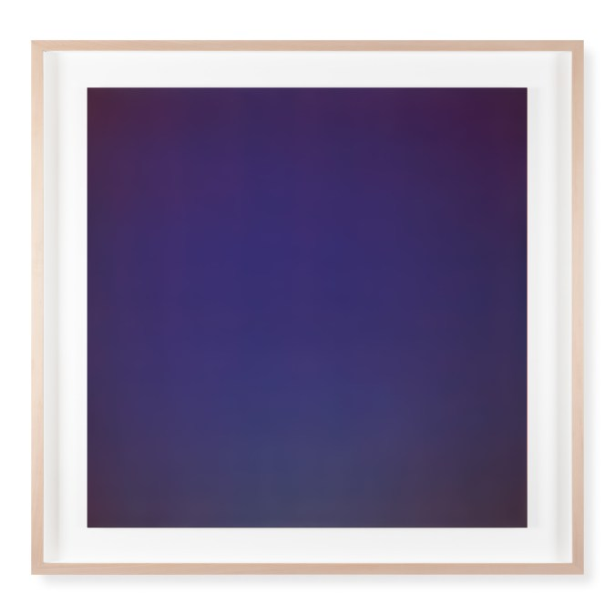 A framed photograph of a blue color field, bright blue in the center and dark blue at each corner