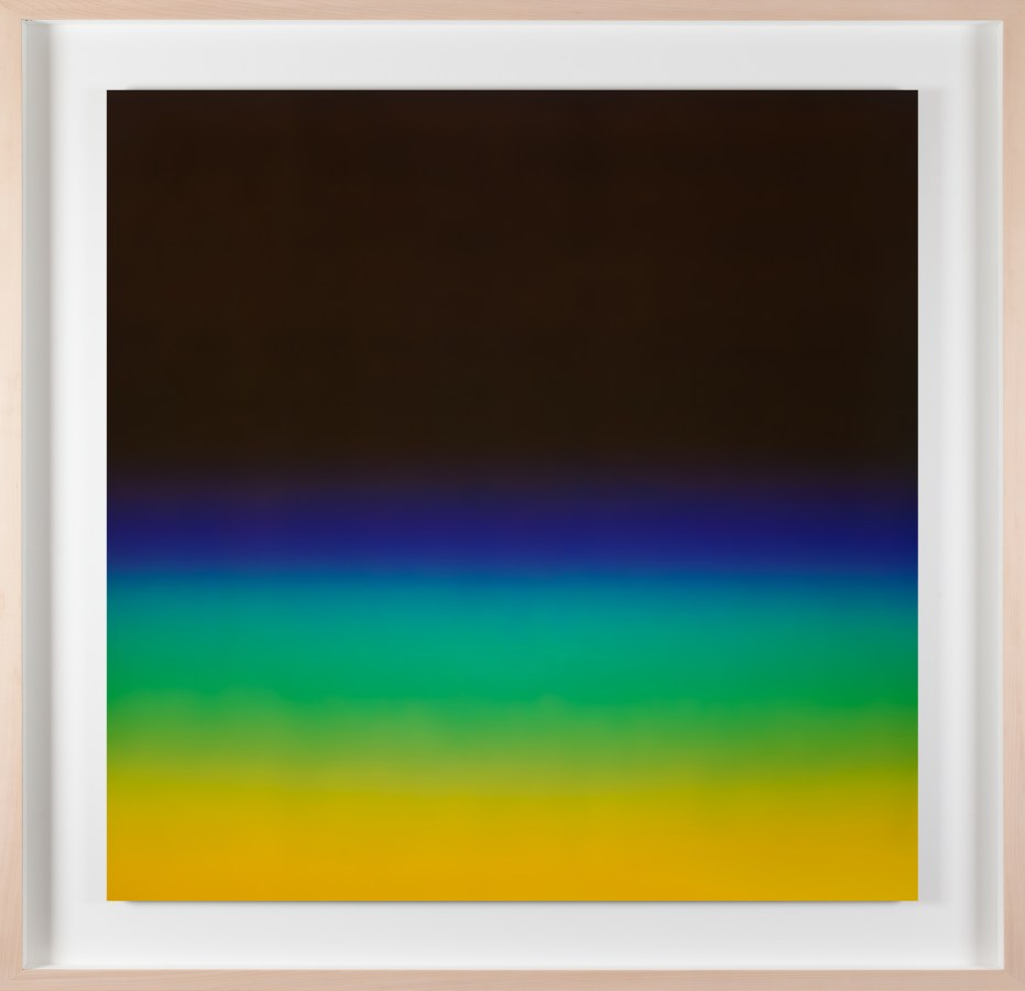 A framed photograph of a black color field with blue, green and yellow gradients on the bottom