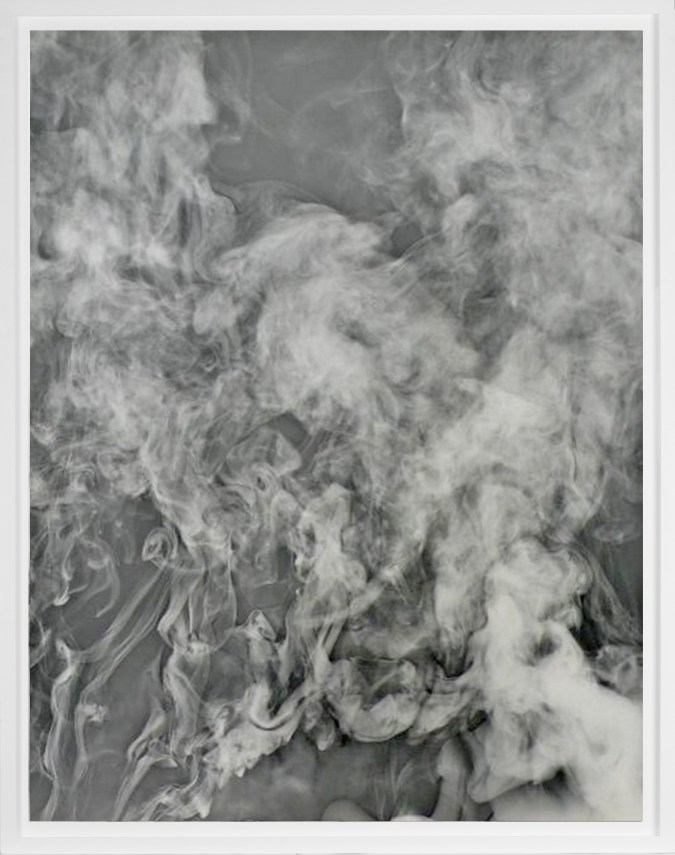 Black-and-white photogram of smoke rising against a grey background
