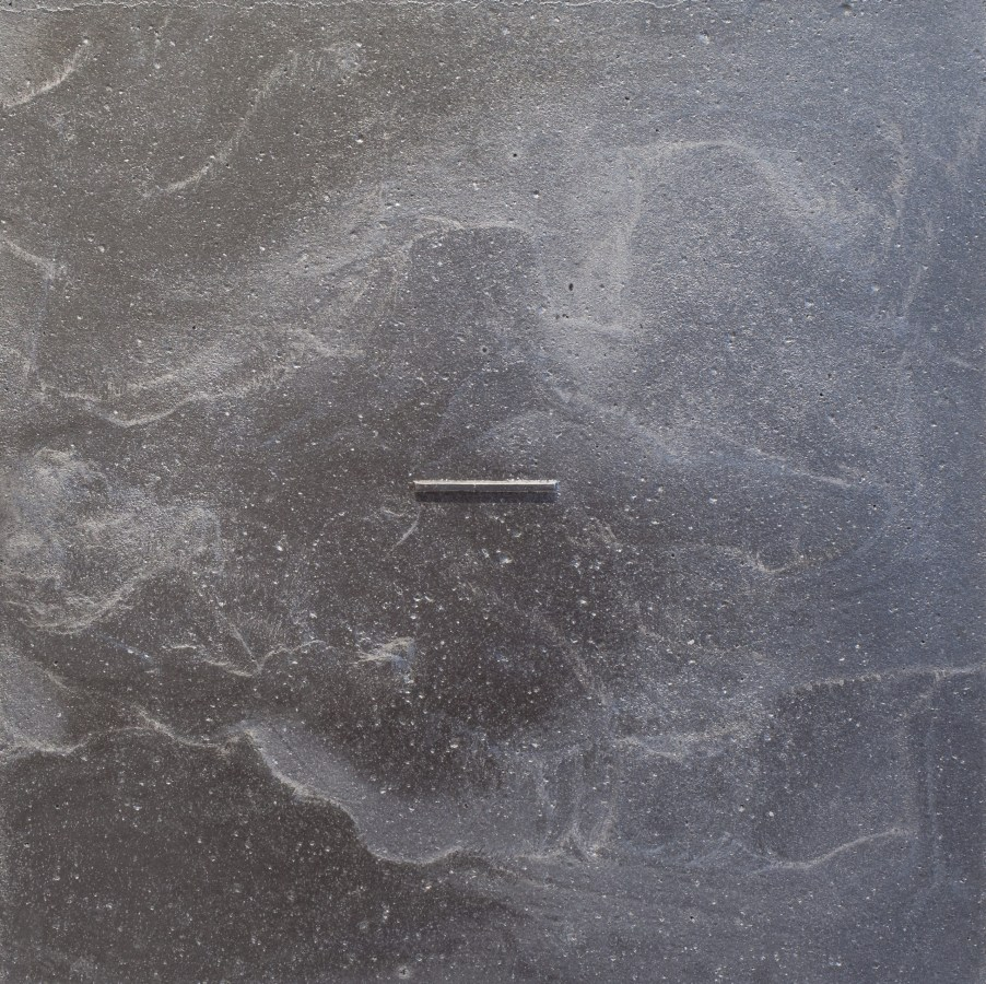 Single dash line of metal embedded into a square metallic surface
