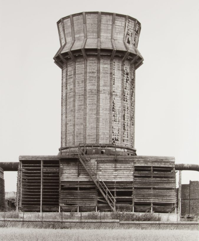 black and white photograph of a cooling tower