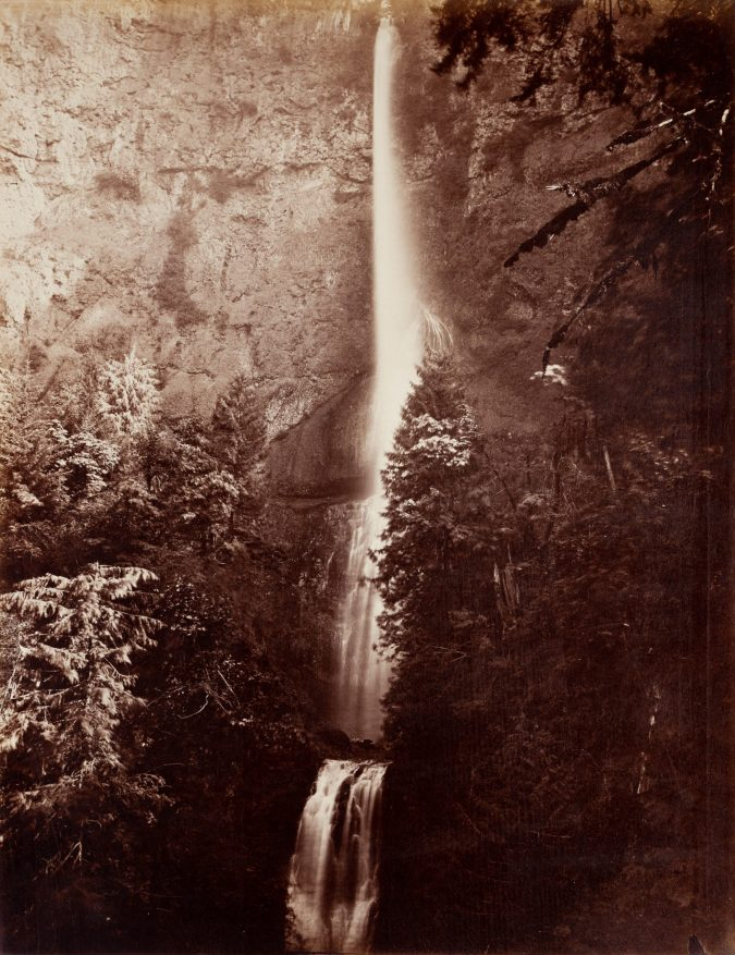 19th century photograph of a waterfall down a cliff