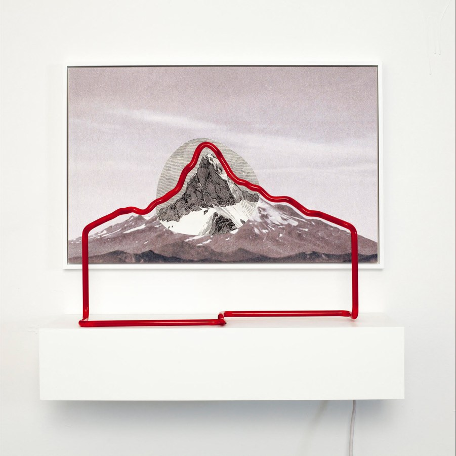 Collage of an etched print and photograph of a mountain outlined by red neon light on a shelf in front of it