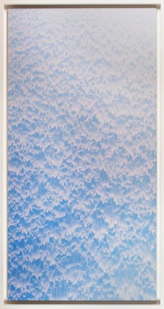 Blue photograph of a cascade of water.