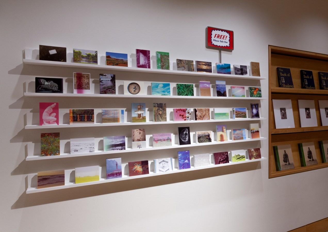 Installation photograph of various postcards on shelves