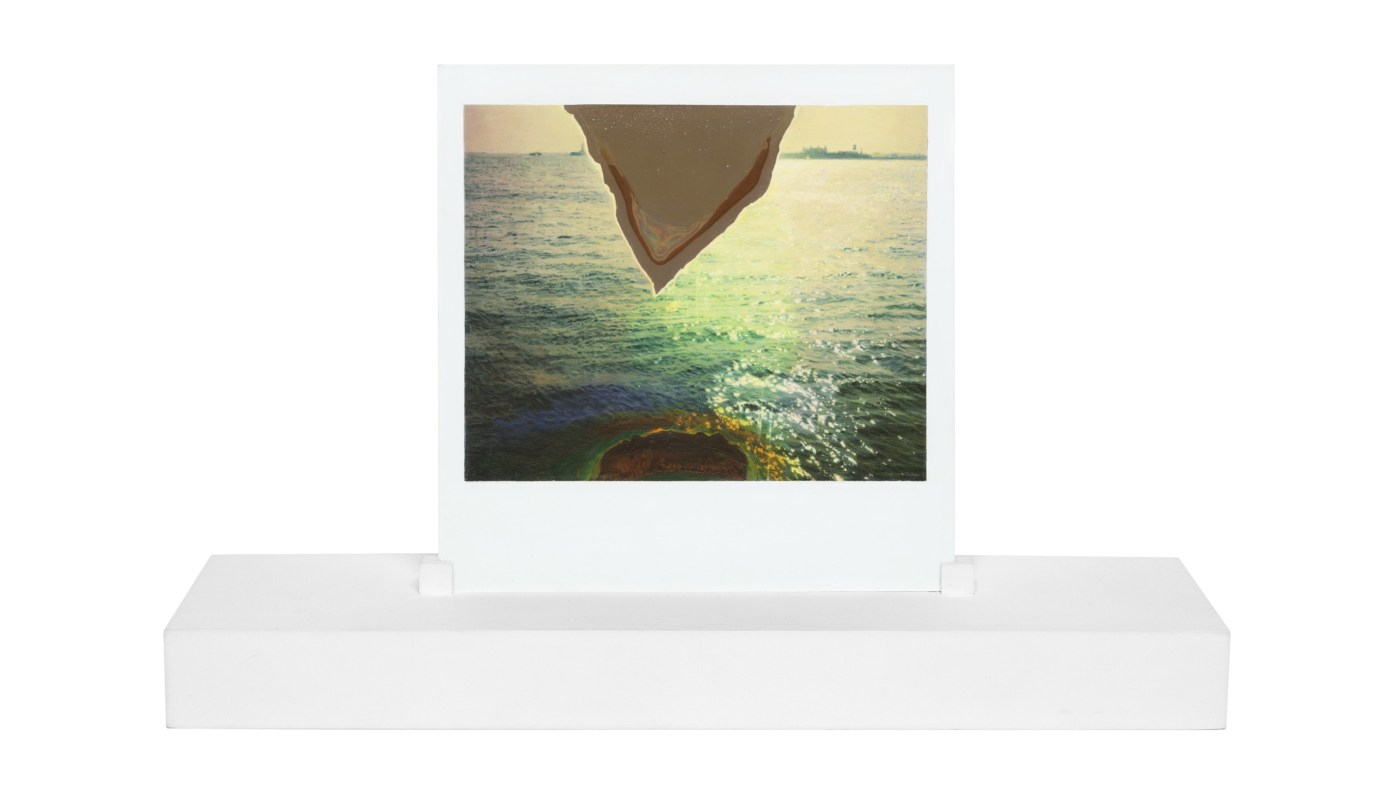 A painting of a polaroid photograph, on a white stand, made at one-to-one scale. The photograph depicts the surface of the ocean, with a triangle of emulsion loss cutting through the top center of the image.