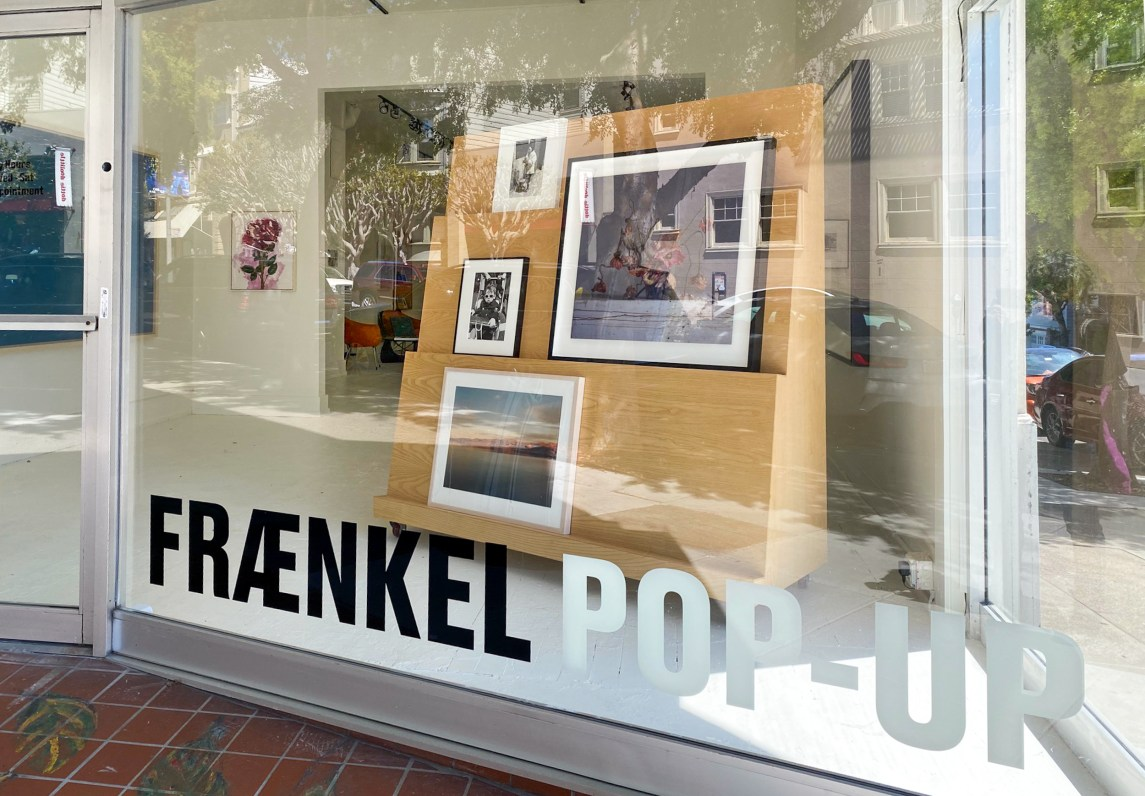 Colorful image of a building with large windows displaying artwork on view and a sign that reads Fraenkel Pop-up
