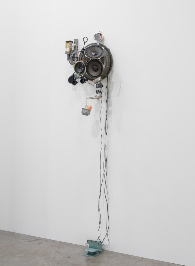 Installation view of a mixed-media sculpture installed on a wall.
